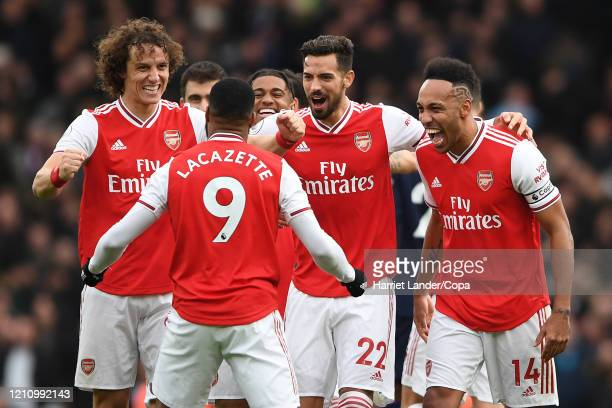 Alexandre Lacazette of Arsenal celebrates with teammates after scoring his team's first goal following a length VAR review during the Premier League...