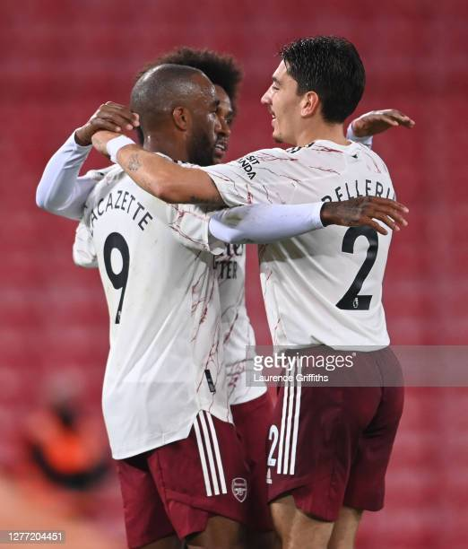 Alexandre Lacazette of Arsenal celebrates with teammates after scoring his sides first goal during the Premier League match between Liverpool and...
