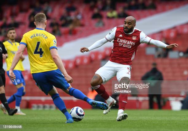 Alexandre Lacazette of Arsenal challenges Adam Webster of Brighton during the Premier League match between Arsenal and Brighton & Hove Albion at...