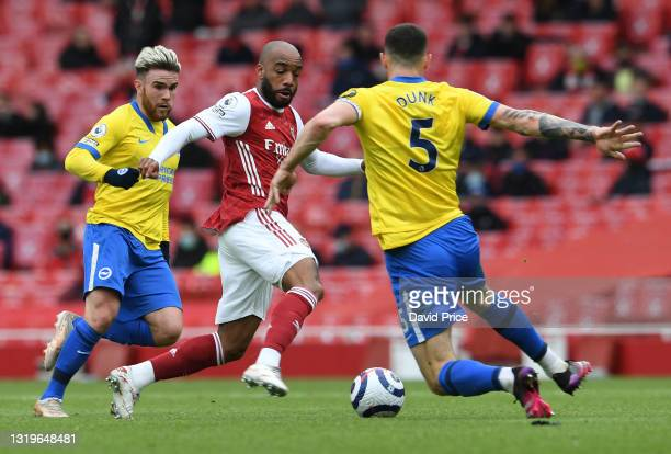 Alexandre Lacazette of Arsenal challenges Lewis Dunk of Brighton during the Premier League match between Arsenal and Brighton & Hove Albion at...