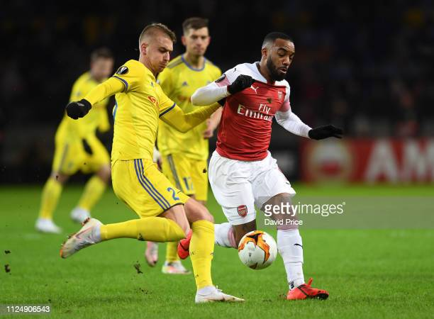 Alexandre Lacazette of Arsenal challenges Zakhar Volkov of BATE during the UEFA Europa League Round of 32 First Leg match between BATE Borisov and...