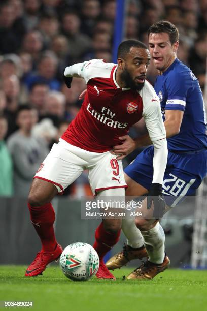 Alexandre Lacazette of Arsenal competes with Cesar Azpilicueta of Chelsea during the Carabao Cup SemiFinal first leg match between Chelsea and...