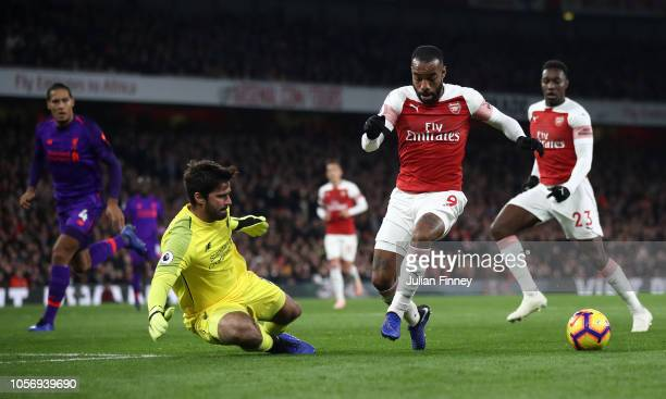 Alexandre Lacazette of Arsenal controls the ball ahead of scoring his sides first goal during the Premier League match between Arsenal FC and...