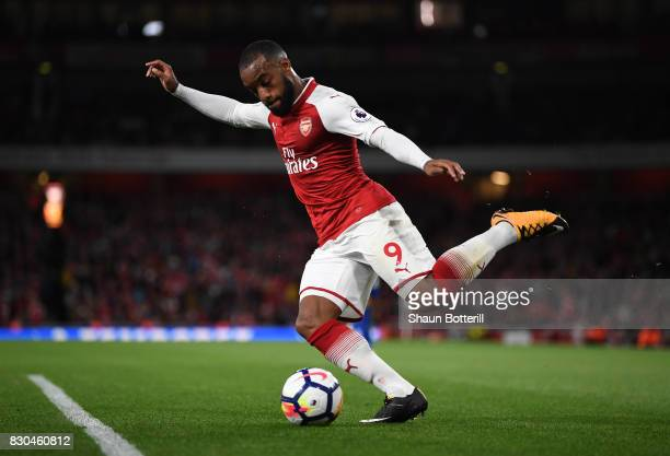 Alexandre Lacazette of Arsenal crosses the ball during the Premier League match between Arsenal and Leicester City at the Emirates Stadium on August...