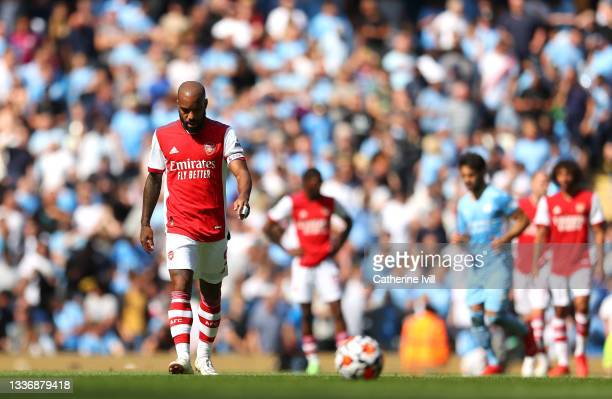 Alexandre Lacazette of Arsenal cuts a dejected figure after conceding a fifth goal during the Premier League match between Manchester City and...