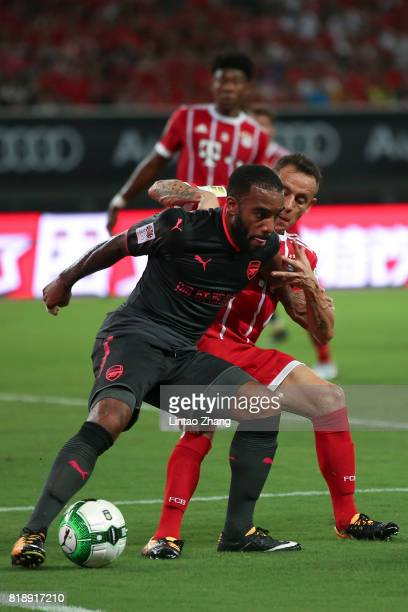 Alexandre Lacazette of Arsenal FC of Arsenal FC competes for the ball with Rafinha of FC Bayern during the 2017 International Champions Cup football...