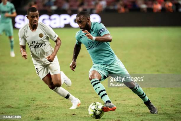 Alexandre Lacazette of Arsenal fights for the ball with Antoine Bernede of Paris Saint Germain during the International Champions Cup 2018 match...
