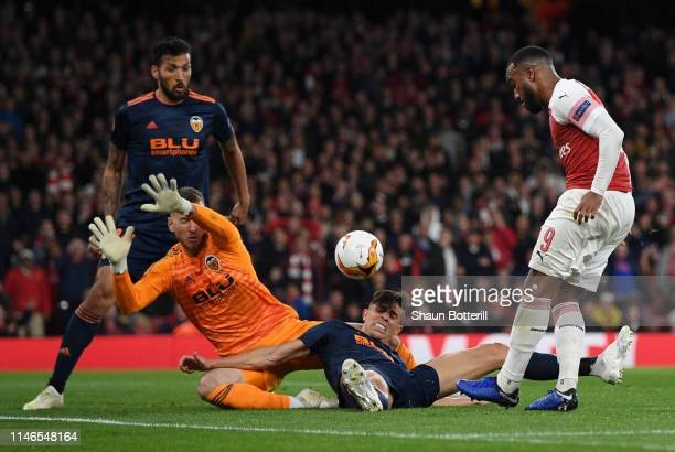 Alexandre Lacazette of Arsenal has his shot blocked by Norberto Murara Neto and Gabriel Paulista of Valencia during the UEFA Europa League Semi Final...