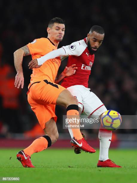 Alexandre Lacazette of Arsenal holds off Dejan Lovren of Liverpool during the Premier League match between Arsenal and Liverpool at Emirates Stadium...