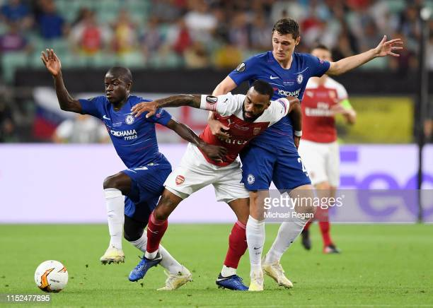 Alexandre Lacazette of Arsenal is challenged by Andreas Christiansen of Chelsea during the UEFA Europa League Final between Chelsea and Arsenal at...