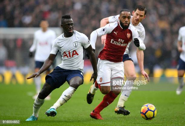 Alexandre Lacazette of Arsenal is challenged by Davinson Sanchez of Tottenham Hotspur during the Premier League match between Tottenham Hotspur and...