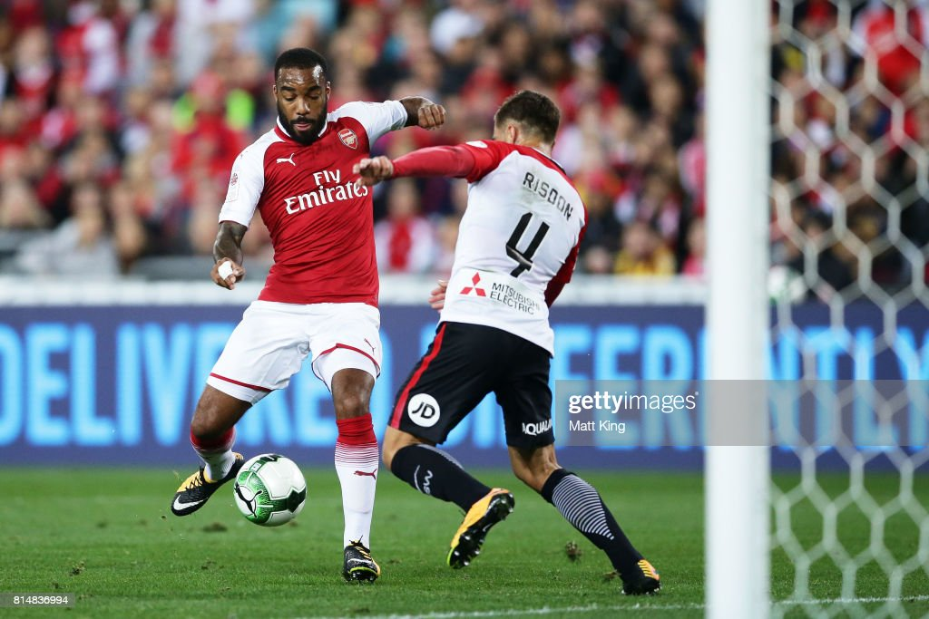 Alexandre Lacazette of Arsenal is challenged by Josh Risdon of the Wanderers during the match between the Western Sydney Wanderers and Arsenal FC at ANZ Stadium on July 15, 2017 in Sydney, Australia.