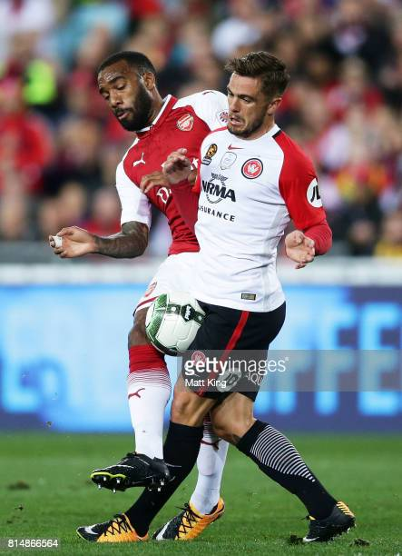 Alexandre Lacazette of Arsenal is challenged by Josh Risdon of the Wanderers during the match between the Western Sydney Wanderers and Arsenal FC at...
