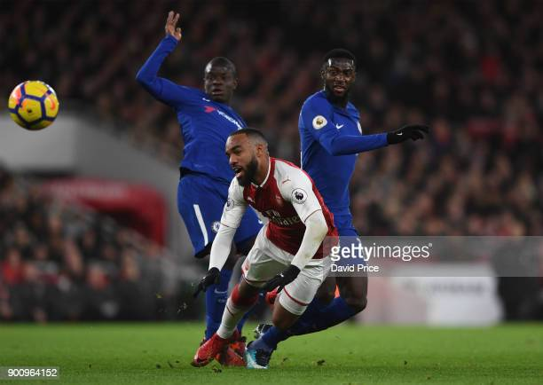 Alexandre Lacazette of Arsenal is challenged by N'Golo Kante and Tiemoue Bakayoko of Chelsea during the Premier League match between Arsenal and...