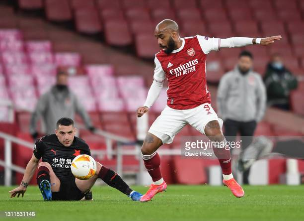 Alexandre Lacazette of Arsenal is challenged by Nicolae Stanciu of Slavia during the UEFA Europa League Quarter Final First Leg match between Arsenal...