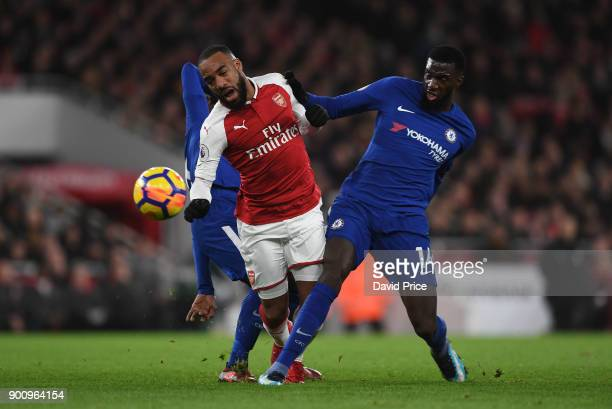 Alexandre Lacazette of Arsenal is challenged by Tiemoue Bakayoko of Chelsea during the Premier League match between Arsenal and Chelsea at Emirates...