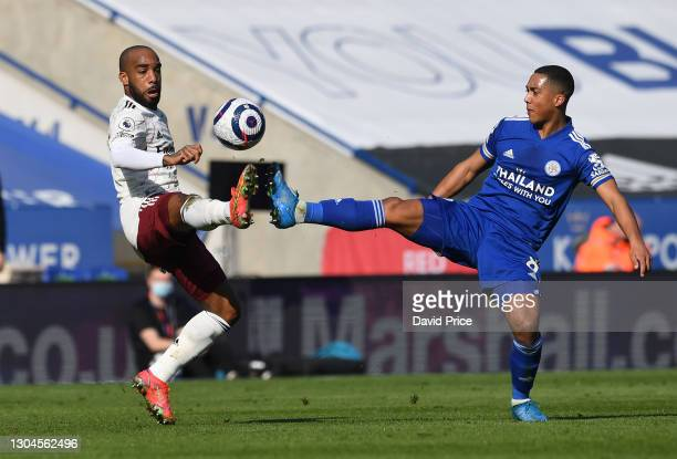 Alexandre Lacazette of Arsenal is challenged for the ball by Youri Tielemans of Leicester during the Premier League match between Leicester City and...