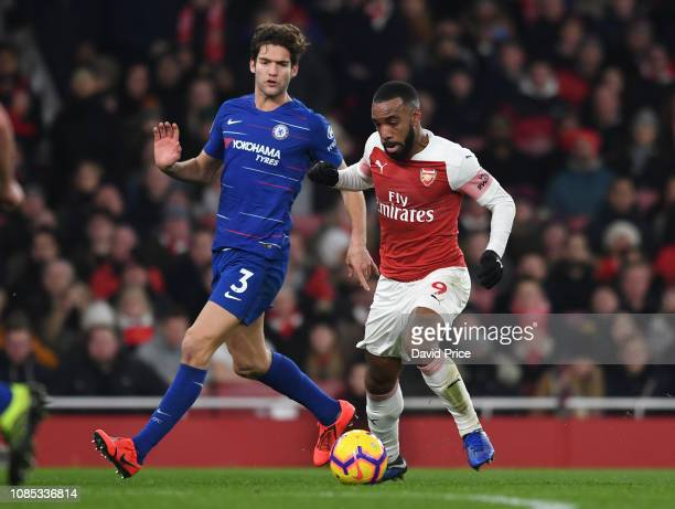 Alexandre Lacazette of Arsenal is closed down by Marcos Alonso of Chelsea during the Premier League match between Arsenal FC and Chelsea FC at...