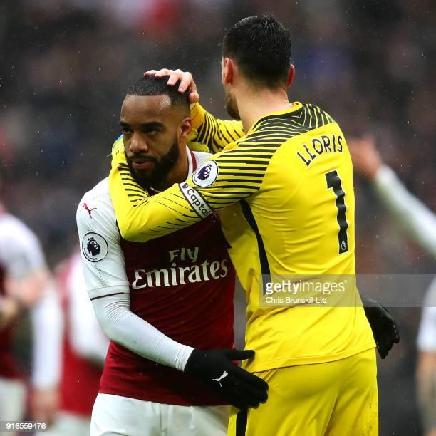 Alexandre Lacazette of Arsenal is consoled by Hugo Lloris of Tottenham Hotspur following the Premier League match between Tottenham Hotspur and...