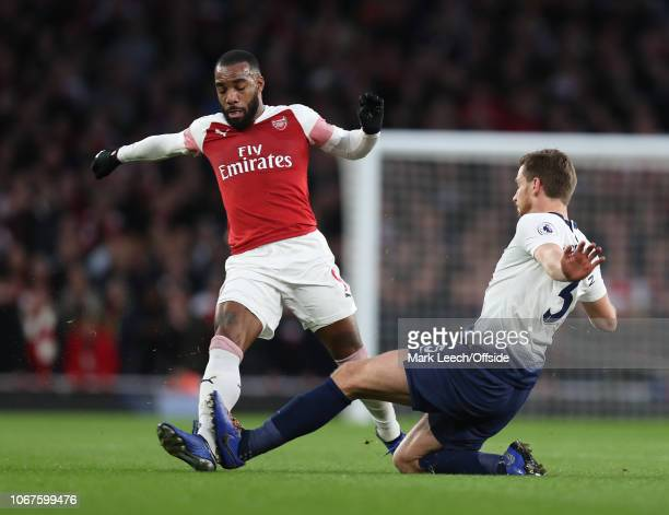 Alexandre Lacazette of Arsenal is fouled by Jan Vertonghen of Tottenham who received his second yellow card during the Premier League match between...