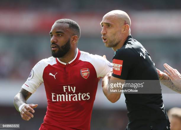 Alexandre Lacazette of Arsenal is held by Pablo Zabaleta of West Ham during the Premier League match between Arsenal and West Ham United at Emirates...