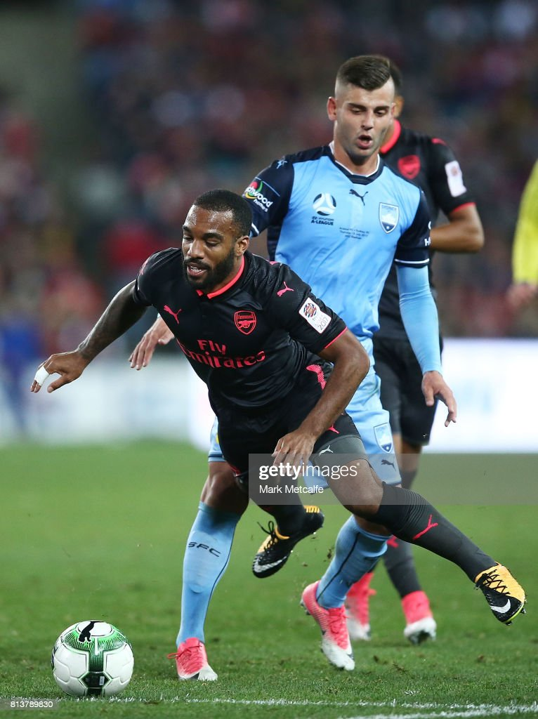 Alexandre Lacazette of Arsenal is tackled by Christopher Zuvela of Sydney FC during the match between Sydney FC and Arsenal FC at ANZ Stadium on July 13, 2017 in Sydney, Australia.