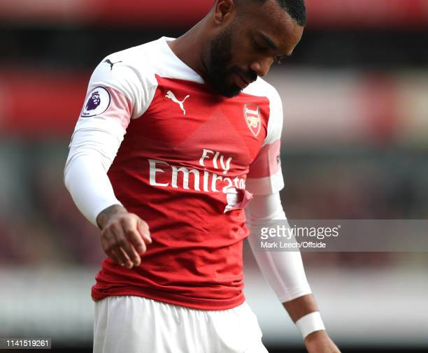 Alexandre Lacazette of Arsenal looking dejected with a torn jersey during the Premier League match between Arsenal FC and Brighton Hove Albion at...
