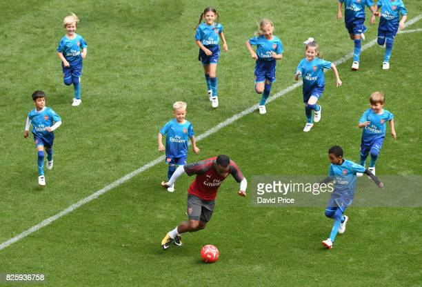 Alexandre Lacazette of Arsenal plays football with the Junior Gunners after the Arsenal Training Session at Emirates Stadium on August 3 2017 in...