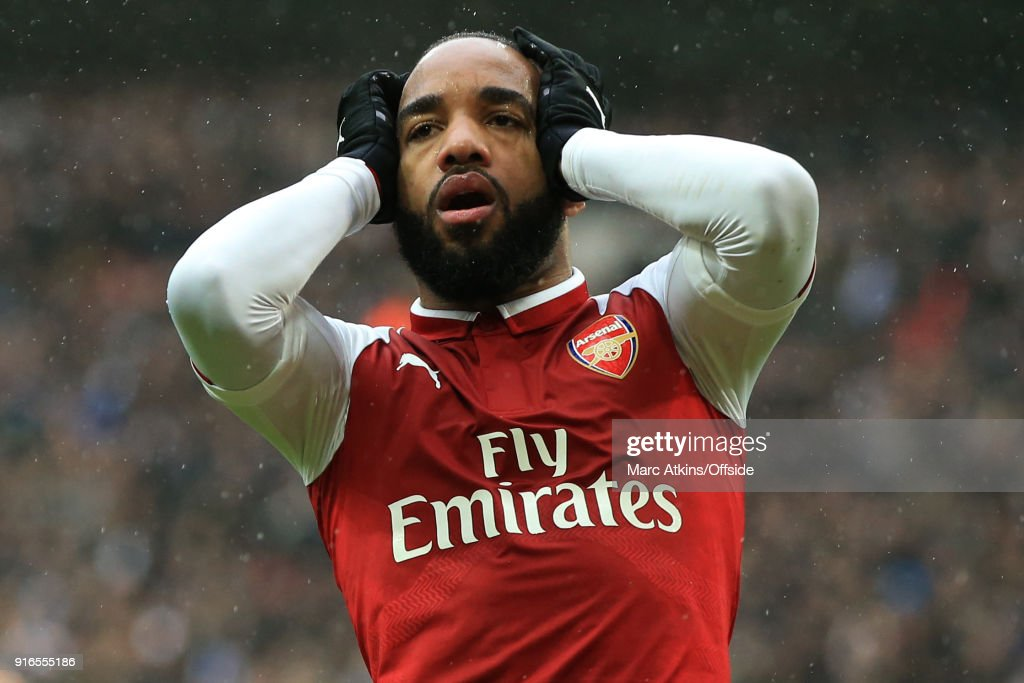 Alexandre Lacazette of Arsenal reacts after a late miss during the Premier League match between Tottenham Hotspur and Arsenal at Wembley Stadium on February 10, 2018 in London, England.