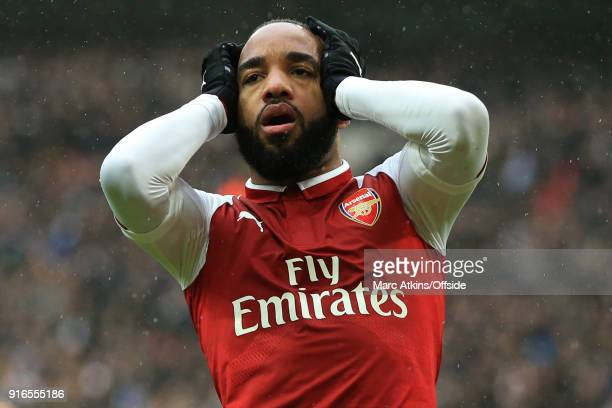 Alexandre Lacazette of Arsenal reacts after a late miss during the Premier League match between Tottenham Hotspur and Arsenal at Wembley Stadium on...