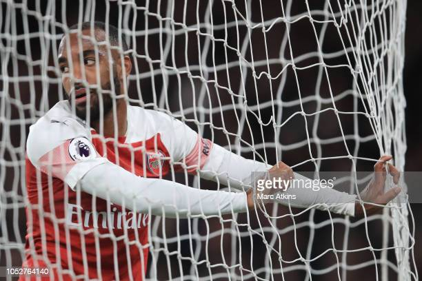 Alexandre Lacazette of Arsenal reacts after a missed chance during the Premier League match between Arsenal FC and Leicester City at Emirates Stadium...