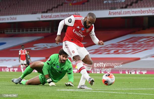 Alexandre Lacazette of Arsenal rounds Liverpool goalkeeper Alisson Becker to score during the Premier League match between Arsenal FC and Liverpool...
