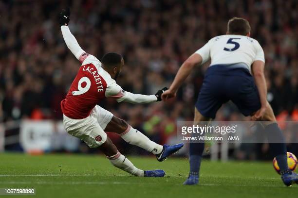 Alexandre Lacazette of Arsenal scores a goal to make it 32 during the Premier League match between Arsenal FC and Tottenham Hotspur at Emirates...
