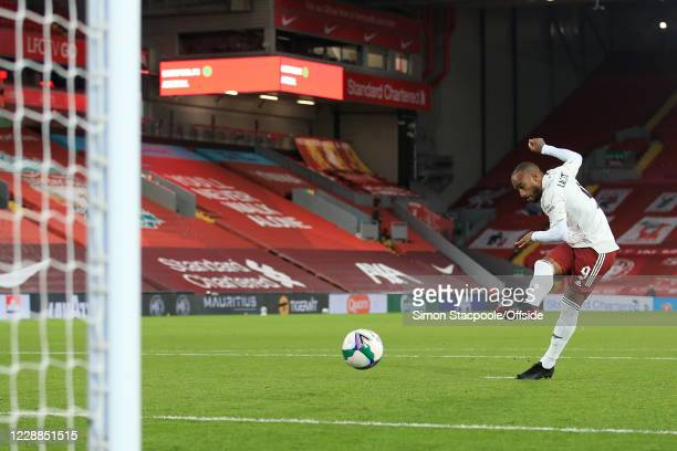 Alexandre Lacazette of Arsenal scores his penalty in the shootout during the Carabao Cup Fourth Round match between Liverpool and Arsenal at Anfield...