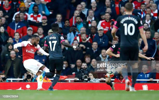 Alexandre Lacazette of Arsenal scores his sides first goal during the Premier League match between Arsenal FC and Everton FC at Emirates Stadium on...