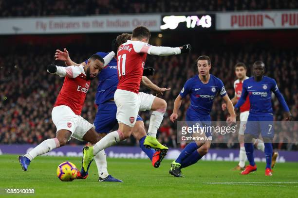 Alexandre Lacazette of Arsenal scores his sides first goal during the Premier League match between Arsenal FC and Chelsea FC at Emirates Stadium on...