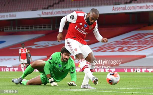Alexandre Lacazette of Arsenal scores his sides first goal during the Premier League match between Arsenal FC and Liverpool FC at Emirates Stadium on...