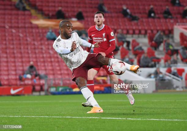Alexandre Lacazette of Arsenal scores his sides first goal during the Premier League match between Liverpool and Arsenal at Anfield on September 28,...