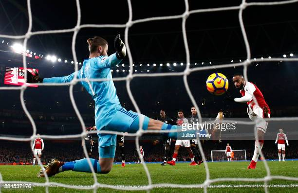 Alexandre Lacazette of Arsenal scores his sides first goal during the Premier League match between Arsenal and Manchester United at Emirates Stadium...