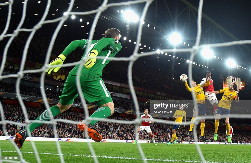 Alexandre Lacazette of Arsenal scores his sides first goal during the UEFA Europa League Semi Final leg one match between Arsenal FC and Atletico Madrid at Emirates Stadium on April 26, 2018 in London, United Kingdom.