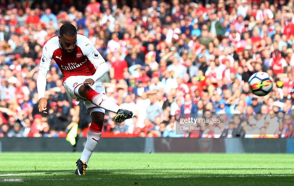 Alexandre Lacazette of Arsenal scores his sides second goal during the Premier League match between Arsenal and AFC Bournemouth at Emirates Stadium on September 9, 2017 in London, England.