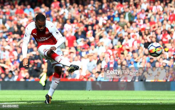 Alexandre Lacazette of Arsenal scores his sides second goal during the Premier League match between Arsenal and AFC Bournemouth at Emirates Stadium...