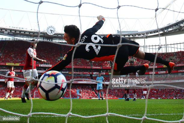 Alexandre Lacazette of Arsenal scores his sides second goal past Nick Pope of Burnley during the Premier League match between Arsenal and Burnley at...