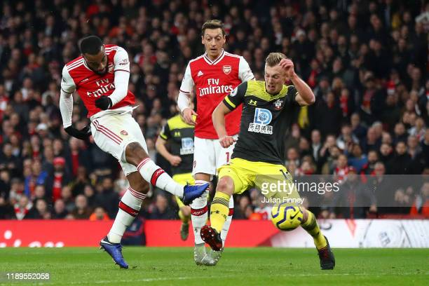 Alexandre Lacazette of Arsenal scores his team's first goal during the Premier League match between Arsenal FC and Southampton FC at Emirates Stadium...