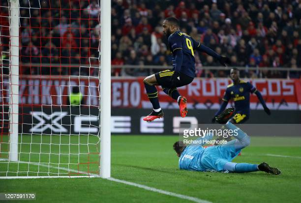 Alexandre Lacazette of Arsenal scores his teams first goal during the UEFA Europa League round of 32 first leg match between Olympiacos FC and...