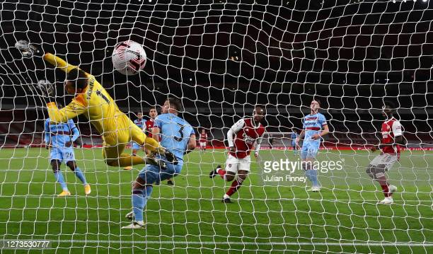 Alexandre Lacazette of Arsenal scores his team's first goal past Lukasz Fabianski of West Ham United during the Premier League match between Arsenal...