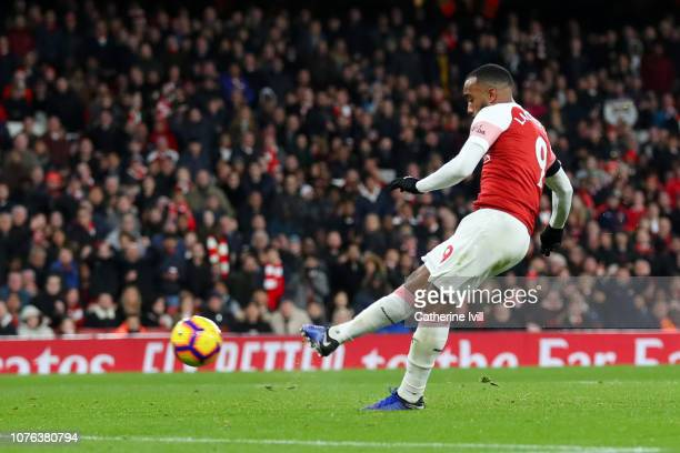 Alexandre Lacazette of Arsenal scores his team's second goal during the Premier League match between Arsenal FC and Fulham FC at Emirates Stadium on...