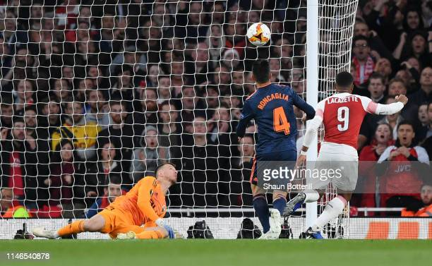 Alexandre Lacazette of Arsenal scores his team's second goal during the UEFA Europa League Semi Final First Leg match between Arsenal and Valencia at...