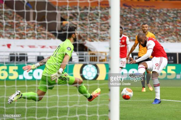 Alexandre Lacazette of Arsenal scores his team's second goal during the Premier League match between Wolverhampton Wanderers and Arsenal FC at...