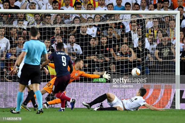 Alexandre Lacazette of Arsenal scores his team's second goal past Norberto Murara Neto of Valencia during the UEFA Europa League Semi Final Second...